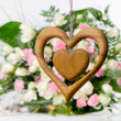 Wooden heart on flower background — Stock fotografie