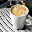 Coffee maker pouring  espresso coffee in  cup — Stock Photo
