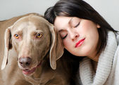 Young beautiful women with dog — Stock Photo