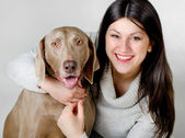 Young smiling women with dog — Stock Photo