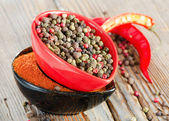 Black pepper and red pepper — Stock Photo