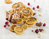 Spices and dried oranges — Stock Photo