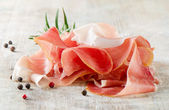 Slices of ham and herbs — Stock Photo