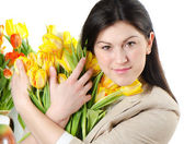 Beautiful happy woman with tulips — Stock Photo