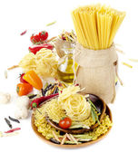 Italian food - pasta , olive oil and fresh vegetables — Stock Photo