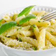 Italian food - Pasta with pesto and basil — Stock Photo