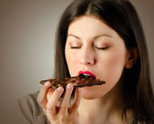 Woman with with a chocolate bar — Stock Photo