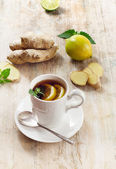 Tea cup and ginger — Stock Photo