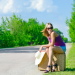 Pretty young woman waiting on the road — Stock Photo #28267123