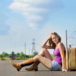 Pretty young woman waiting on the road — Stockfoto