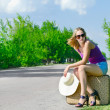 Pretty young woman waiting on the road — Stock Photo #28267639