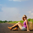 Pretty young woman waiting on the road — Stock Photo #28267713