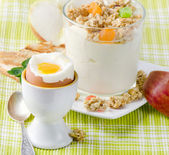 Healthy breakfast - boiled egg , yogurt with muesli — Stock Photo