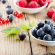 Blueberries and raspberry on wooden table — Stock Photo #28722975