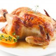 Roasted chicken on white plate with orange — Stock Photo