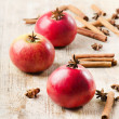 Apples and spices on a wooden table — Stock Photo