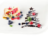 Sweet christmas tree with crepes — Stock Photo