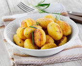 Roasted potatoes with rosemary — Stock Photo