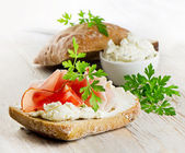 Bread with smoked bacon and cream cheese — Stock Photo