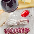 Wine and salami — Stock Photo
