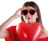 Smiling girl with heart glasses — Stock Photo