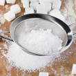 Powdered sugar in a metal sieve — Stock Photo