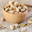 Pistachios on wooden table — Stock Photo