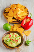 Corn chips and guacamole — Stock Photo