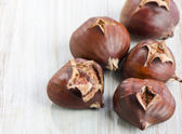 Chestnuts on table — Stock Photo