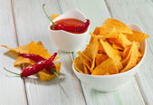 Corn chips with sauce — Stock Photo
