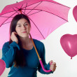Stock Photo: Woman with heart shaped balloons