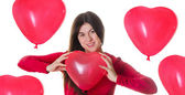 Woman holding red heart shaped balloon — Stock Photo
