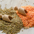 Lentils on a wooden table — Stock Photo
