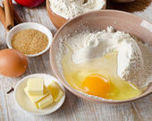 Baking ingredients on a wooden table — Stock Photo