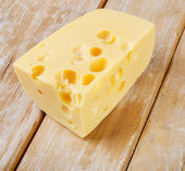 Cheese on wooden table — Stock Photo