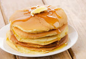 Pancakes topped with honey — Stok fotoğraf
