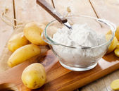 New potatoes and starch — Stock Photo