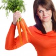 Woman holds bunch of carrots — Stock Photo #43520253