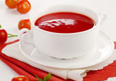 Tomato soup in a white bowl — Stock Photo