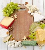 Cheese with fruits and nuts — Stock Photo