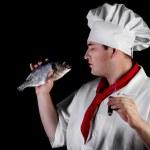 Chef holding raw fish — Stock Photo #47618639