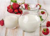 Milk with berries — Stock Photo