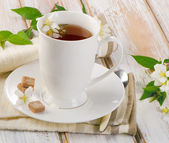 Tea in a white cup with flowers — Foto de Stock