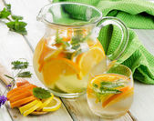 Lemonade with mint leaves — Stock Photo