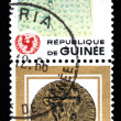 GUINEA - CIRCA 1966: A stamp printed in Guinea shows Children Drawing - African boy play in football, circa 1966 — Stock Photo #12161356