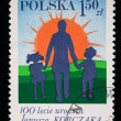 POLAND - CIRCA 1977: A stamp printed in Poland honoring 100 years of Janusz Korczak shows man with girl and boy against sunrise, circa 1977 — Stock Photo