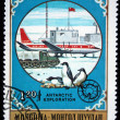Stock Photo: MONGOLIA- CIRCA 1980: A stamp printed in Mongolia shows penguins on the background of Polar station, series Antarctic exploration, circa 1980