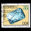 DDR - CIRCA 1985: A stamp printed in DDR (East Germany) shows semiprecious stone Aquamarin, circa 1985 — Stok fotoğraf