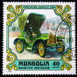 Royalty-Free Stock Photo: MONGOLIA - CIRCA 1980: A postage stamp printed in the Mongolia shows image of the motor industry history - car Armstrong Siddeley 1904, circa 1980