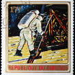 Stock Photo: BURUNDI - CIRC1972: stamp printed in Burundi shows astronaut descends from spacecraft on moon, series, circ1972